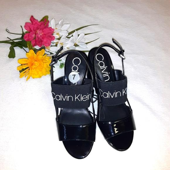 New women's size 7 CALVIN KLEIN black wedge/sandal